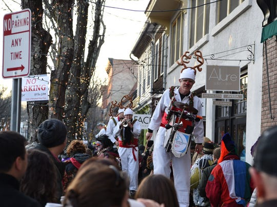 Michael McGuigan of the Shinbone Alley Stilt Band leads the way down Market Street in the Village of Rhinebeck during the Sinterklaas Festival on Saturday.