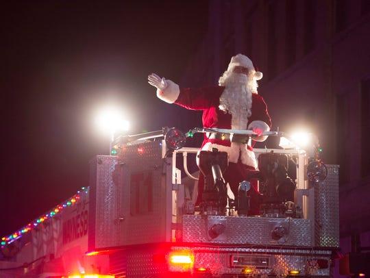 Santa arrives on a Waynesboro firetruck to cap Saturday