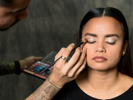 Sean Sapp, Salina's BeautiWorks cosmetologist, then applies a darker eyeshadow to darken and contour the outer edges of the upper eyelids.