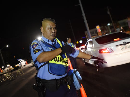In this file photo, the Guam Police Department Highway Patrol Division conducts a DUI checkpoint.