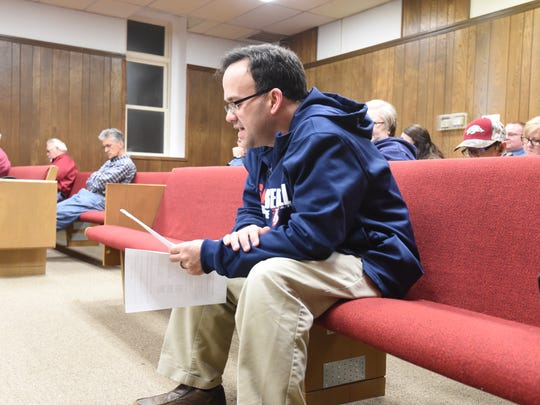 Marion County Attorney Sam Pasthing reads an ordinance aloud during the final 2015 meeting of the Marion County Quorum Court on Tuesday, Dec. 29.