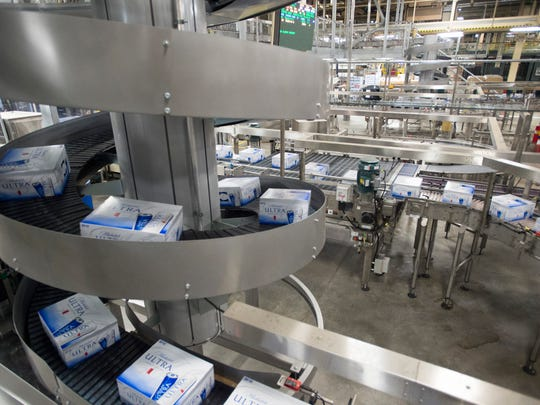 Cases of Michelob Ultra beer move down the canning line at the Anheuser-Busch facility in Fort Collins Wednesday, December 30, 2015. The St. Louis brewing company received tax credits from the state to add a fourth canning line and 41 full-time manufacturing jobs to its Northern Colorado location.