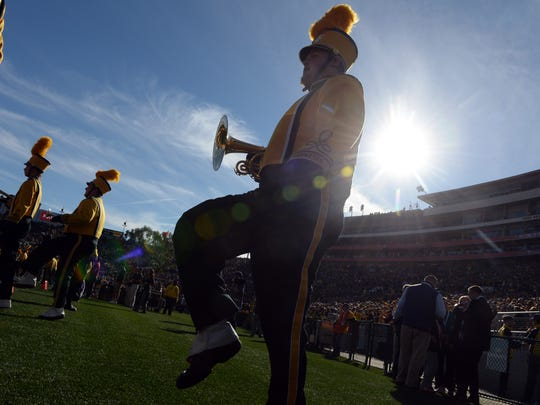 The Iowa Hawkeyes marching band performs before the