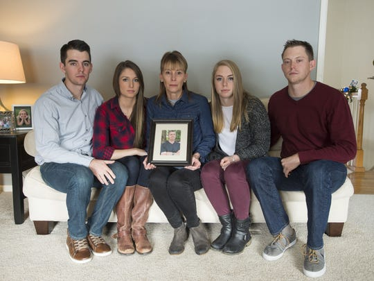 """From left: Mark Towne, Paige Taylor and Cindy, Kiley and Nate Towne celebrated their first Christmas without the """"glue that held their entire family together."""" Stephen Towne was killed January 29 after Alton Massey, a driver with Parkinson's Disease, collided with his vehicle."""