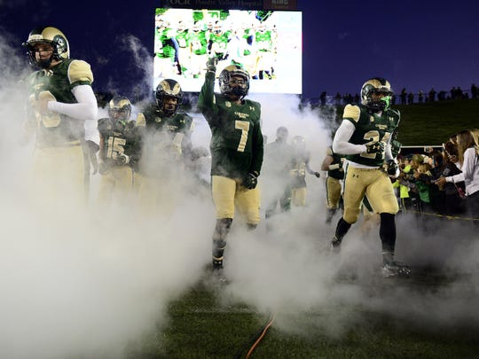 CSU players take the field before a Nov. 14 game at Hughes Stadium. CSU's final game at the stadium, built in 1968, is expected to come in November 2016.