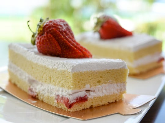 Slices of strawberry shortcake is photographed in the