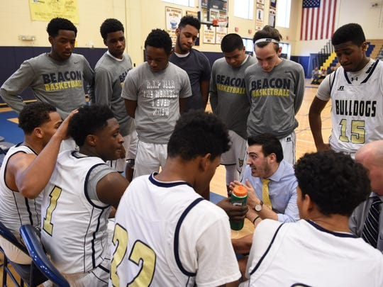 The Beacon High School boys basketball team huddles up during a timeout during a Jan. 9 game against Poughkeepsie in Beacon.