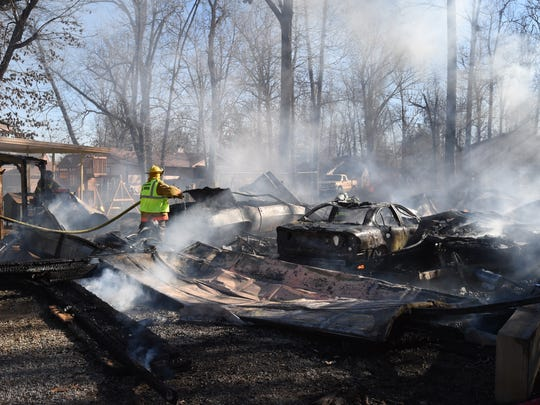 Volunteer firefighters from Northeast Lakeside and Henderson work the scene of a structure fire at 147 Pine Cone Drive in Mountain Home Thursday afternoon.