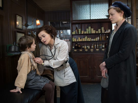 """In this image released by Focus Features, Adam Michael Dodd portrays George Watts, from left, Helena Bonham Carter portrays Edith Ellyn and Carey Mulligan portrays Maud Watts, in a scene from """"Suffragette."""""""