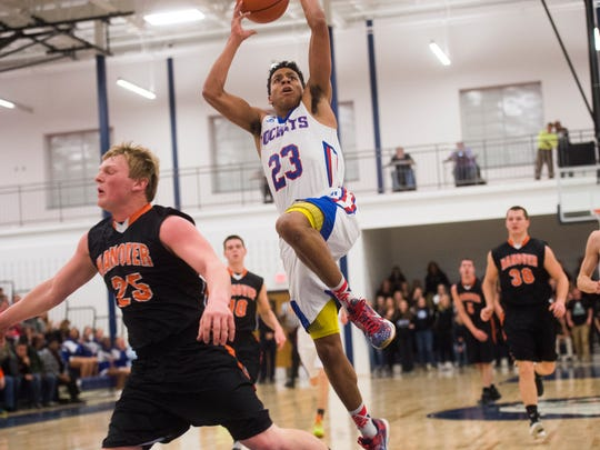 Spring Grove's Eli Brooks leaps for a layup shot against Hanover on Feb. 5, 2016 at West York High School.