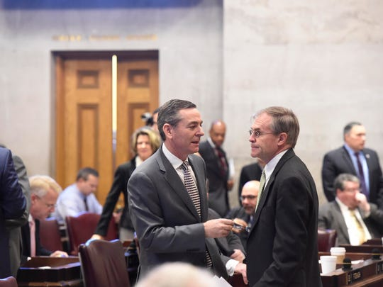 Rep. Glen Casada talks to Rep. Bill Dunn in the House chambers on Thursday.