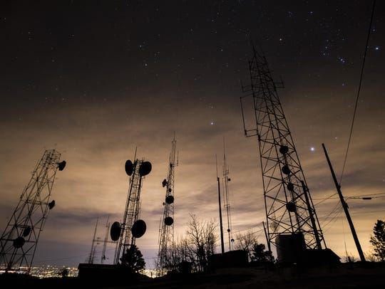 Stars shine above radio towers on top of Rist Canyon