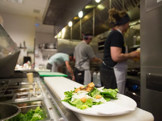 Line cooks work during dinner service at Restaurant 415 on Thursday, Feb. 25, 2016, in Fort Collins. Owners of the restaurant are challenging Larimer County's health inspection system after receiving ratings of 'inadequate' in each of the restaurant's last three full inspections.