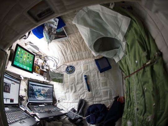 This April 24, 2015 photo provided by NASA shows astronaut Scott Kelly's personal living quarters on the International Space Station.  Kelly sees his nearly completed one-year mission as a 'steppingstone' to Mars. America's record-breaking astronaut will submit to numerous tests when he returns from the International Space Station. Researchers want to see if Kelly would hit the ground running if this were Mars instead of Earth.