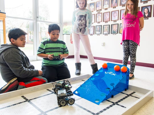 Students control robotic cars at Georgetown Elementary