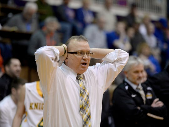 Northeastern coach Brent Ross reacts after Tyler Smith is called for a foul against Union County during the Class 2A basketball sectional semi-finals Friday, March 4, 2016  in Hagerstown.
