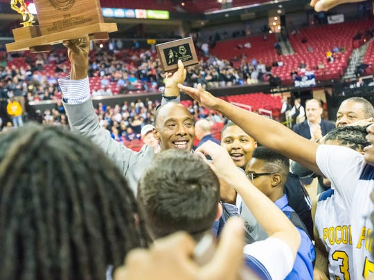 Pocomoke celebrates with head coach Derrick Fooks after taking the MPSSAA 1A State Championship against Lake Clifton at the Xfinity Center in College Park on Saturday, March 12.