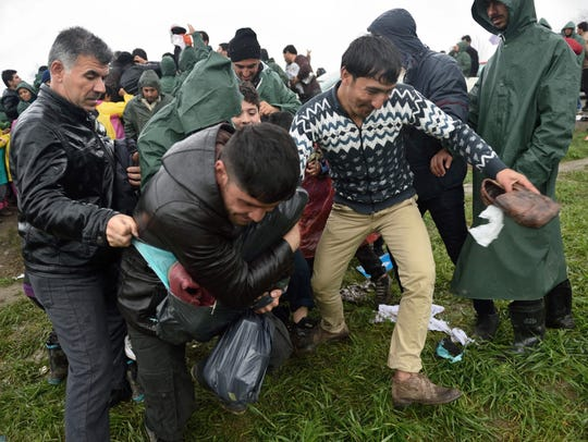 Migrants and refugees fight for aid received as donations