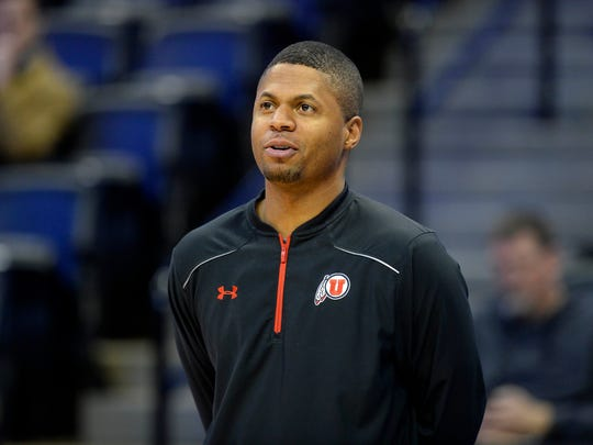 Utah assistant coach DeMarlo Slocum, who helped turn around CSU's program as an assistant under Tim Miles from 2008-11, watches the Utes practice Wednesday at the Pepsi Center in Denver. Utah opens play in the NCAA tournament on Thursday against Fresno State.