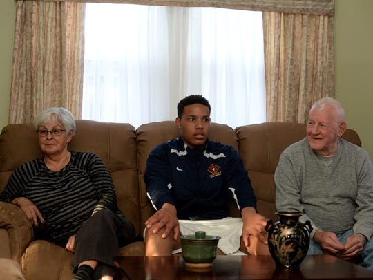 Seton Catholic High School basketball star and Mr. Basketball candidate Desmond Bane with his great grandparents Fabbie Bane and Bob Bane, right, Wednesday, March 16, 2016 at their home in Richmond.