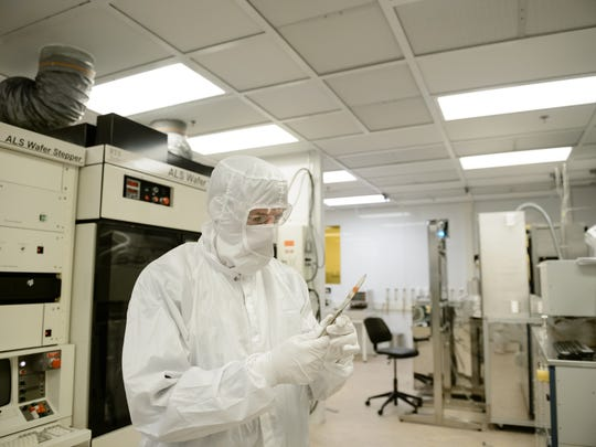 Clemson University optoelectronics researcher Eric Johnson works in a clean room at the university's Advanced Materials Research Laboratory.