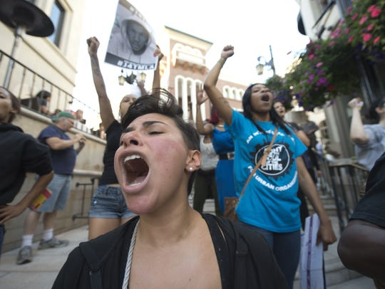 Demonstrators shout during a march to  protest the