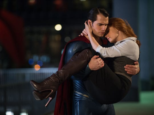 Superman (Henry Cavill) rescues Lois Lane (Amy Adams) from death for the second or third time.