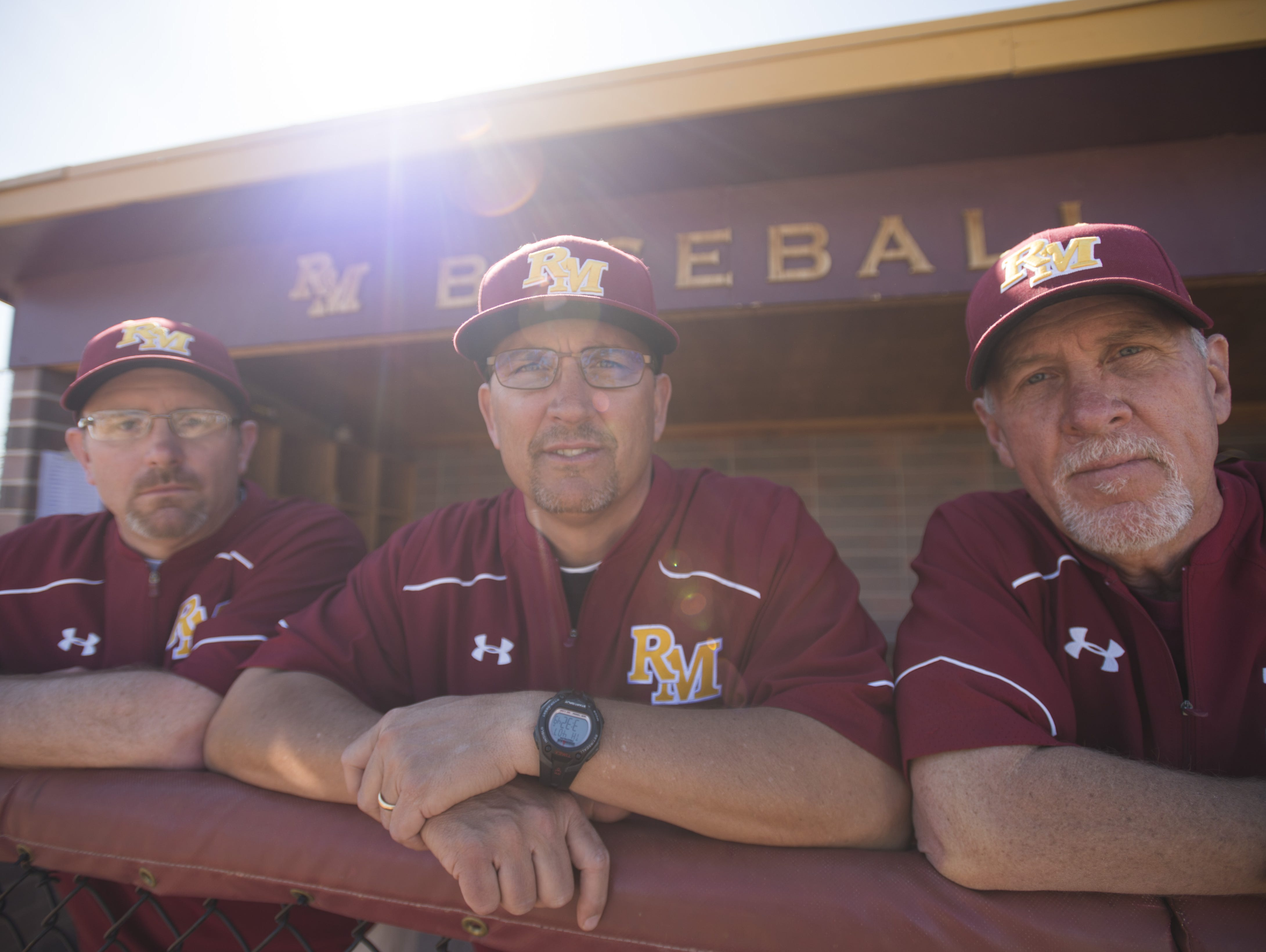 Rocky Mountain High School baseball coach Scott Bullock, center, along with assistants Roy Tripi and Glen Schwab have maintained state-wide success through the years with five titles.
