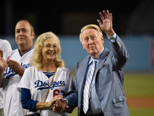 "Vin and Sandi Scully, says close friend Dennis Gilbert, ""still hold hands when they go out to dinner."""