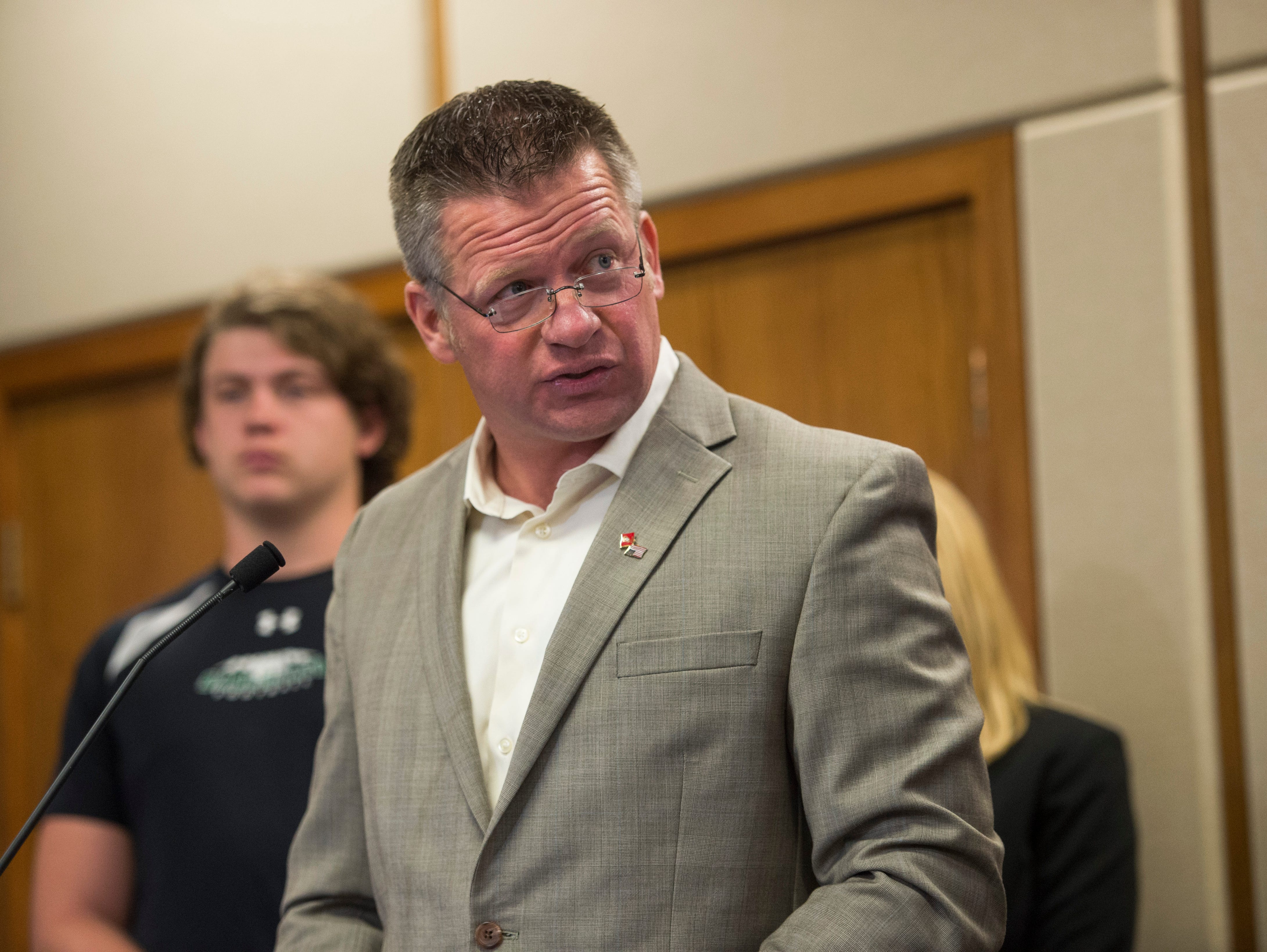 Fossil Ridge High School booster and supporter of former coach Brian Tinker, Randy Russell, speaks before the PSD Board of Education during a meeting Tuesday, April 12, 2016. The coach was fired last month.