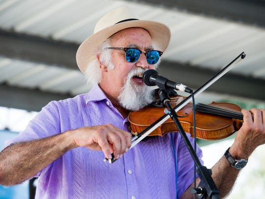 Michael Doucet of the two-time, Grammy-winning Cajun band BeauSoleil served as music director of the first Festival International.