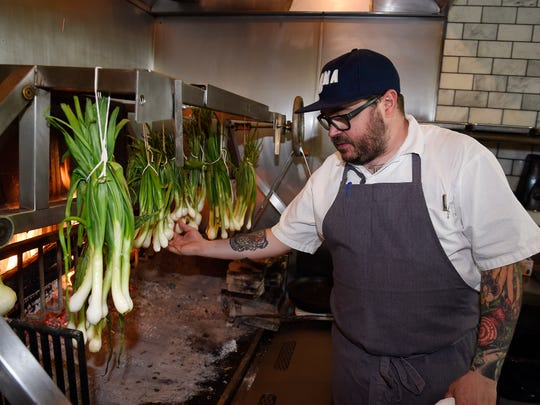 Sean Brock works in his kitchen at Husk on April 18, 2016.