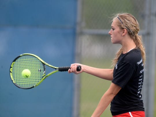 Richmond's Kayla Owens returns the ball in no. 3 singles tennis against Centerville Tuesday, April 26, 2016, at Centerville.
