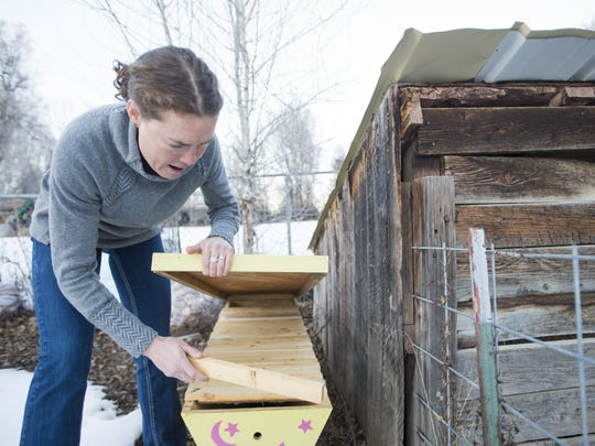Olympic medal-winning cyclist Georgia Gould shows off the bee hives she keeps in her back yard at her Fort Collins home Thursday, January 21, 2016.