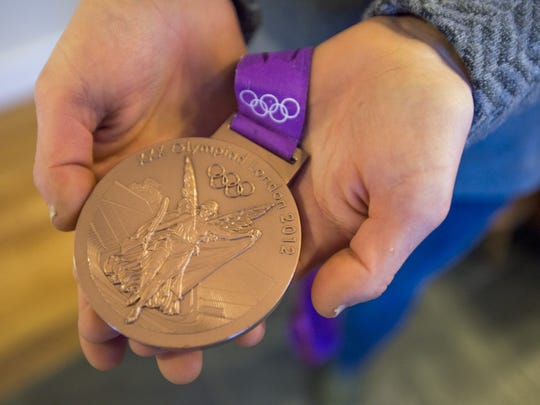 Cyclist Georgia Gould shows off her Olympic Bronze Medal from the London 2012 cross-country cycling event. Gould has been training for the games in Rio de Janeiro later this year.