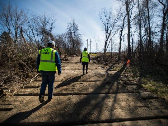 Vermont Gas representatives make their way up an access