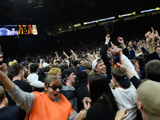 Colorado fans celebrate a defeat of the Arizona Wildcats