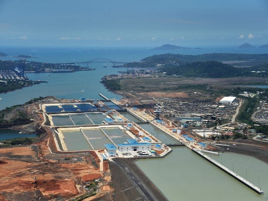 An aerial view of the expanded Panama Canal at the