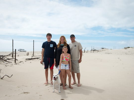 The Berenty's pose for a photo near the dune where