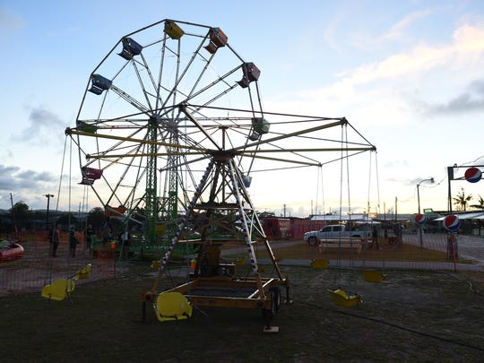 This file photo shows a ferris wheel at the Tiyan Liberation Carnival in June 2016.