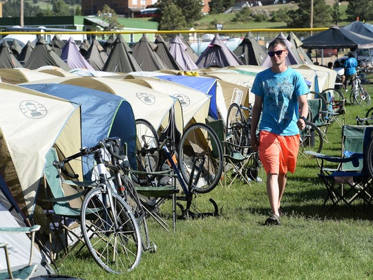 Jake Neuwirth walks through the Ride the Rockies camp in Estes Park on Thursday, June 16, 2016.