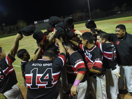 The AutoSpot Canyons celebrate their championship victory over the Barrigada Crusaders at Leo Palace Resort in Yona on June 17. The AutoSpot Canyons won the game 12-4.