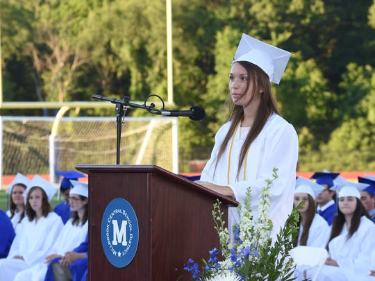 Millbrook High School Salutatorian, Elizabeth Halpin delivers her address during Friday's commencement.
