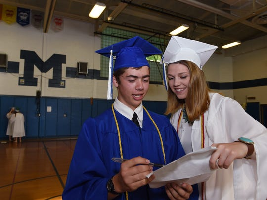 Millbrook High School seniors, Ben Yager and Aimee Jacques review their classmates' names because they are the announcers for Friday's commencement ceremony at Millbrook High School.