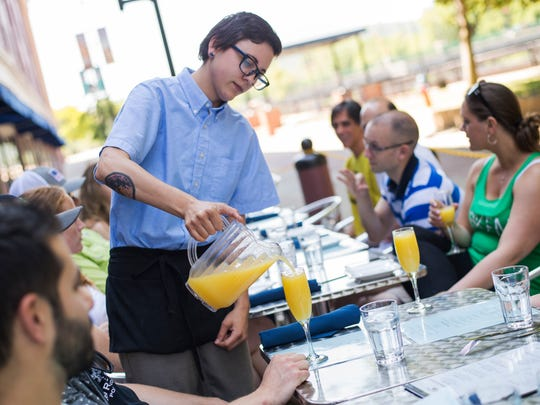 Citrea server Maria Carbone pours mimosas for a table on Saturday morning in Binghamton.