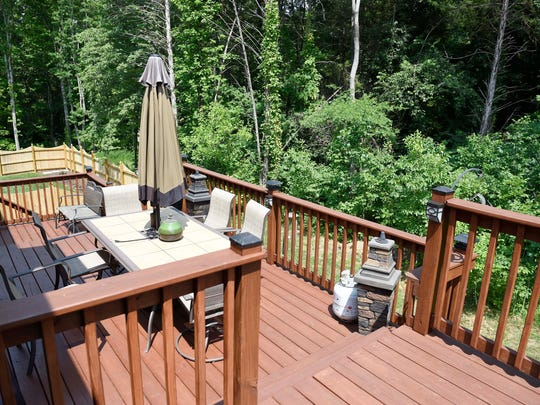 Harriet and Leonard Rudy have added on to their deck in Bellevue and now enjoy the nature close by.
