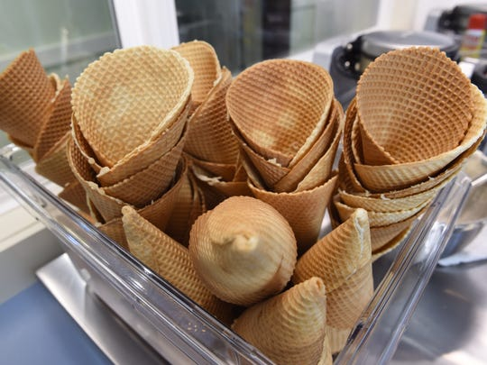 A container of freshly made waffle cones at Zoe's Ice