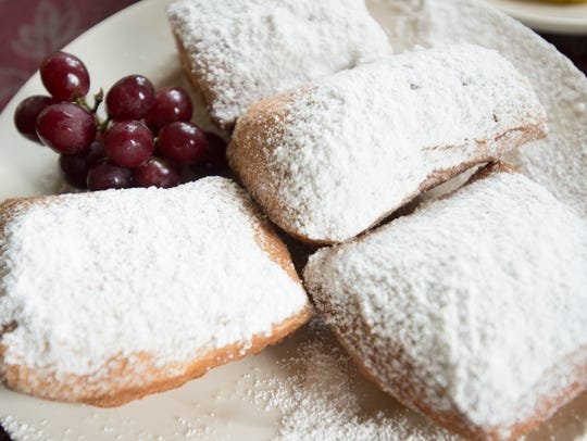 Beignets are a fried pastry. Lucile's owner Fletcher