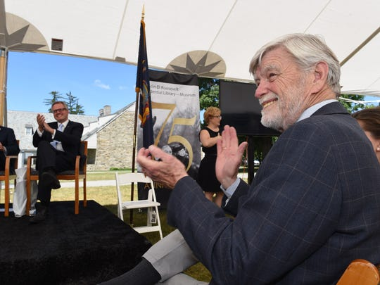 FDR's grandson, David Roosevelt applauds during the FDR Library and Museum 75th anniversary commemoration on Thursday.