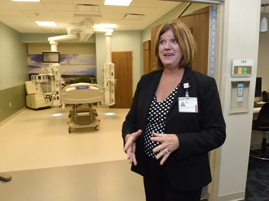 Kathy Prairie, associate chief nursing officer at Vassar Brothers Medical Center, explains some of the benefits the new patient pavilion will have during a tour of the 'Prototype Experience' at Vassar Brothers Medical Center in the City of Poughkeepsie on Thursday.  The 'Prototype Experience' is a full size replica of the new patient pavilion's patient rooms and ICU rooms. Construction on the new pavilion will break ground in September.